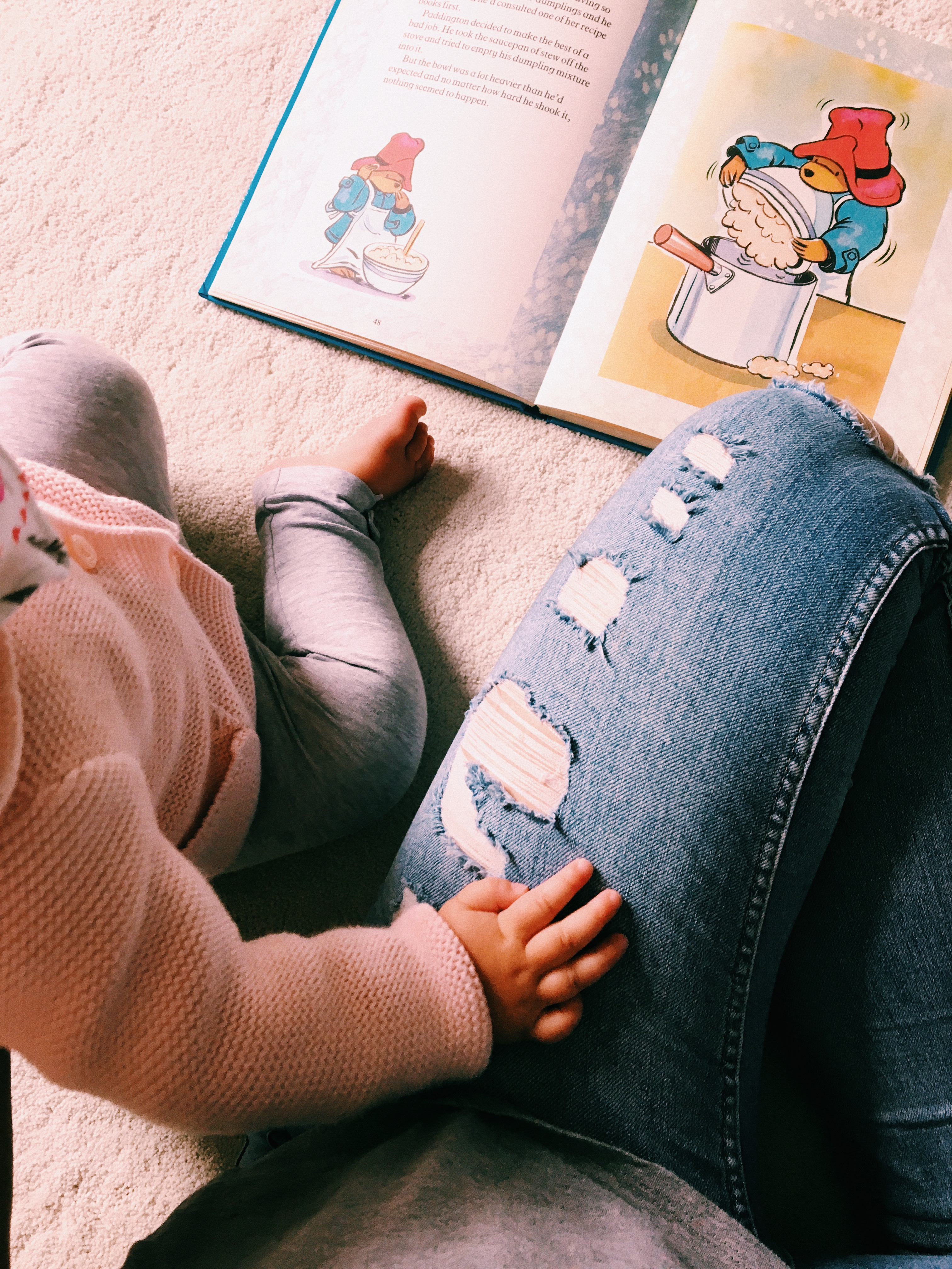 A calm moment reading a book with my daughter in her nursery