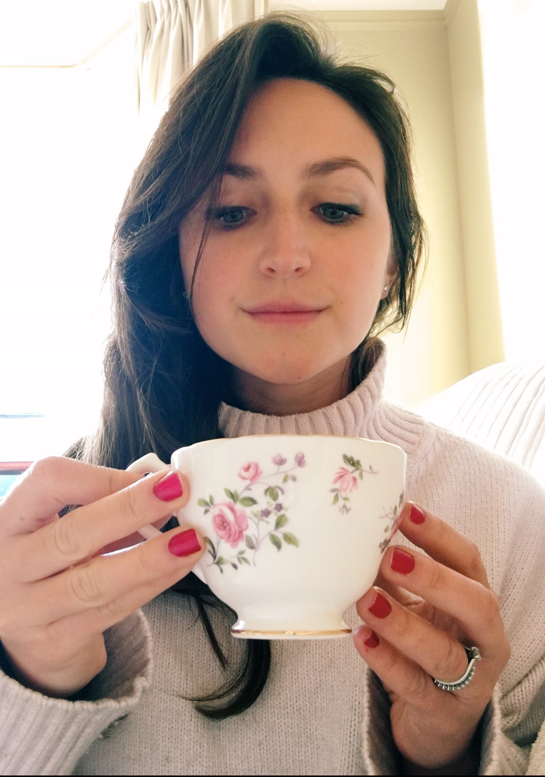 lady drinking tea in a cosy jumper
