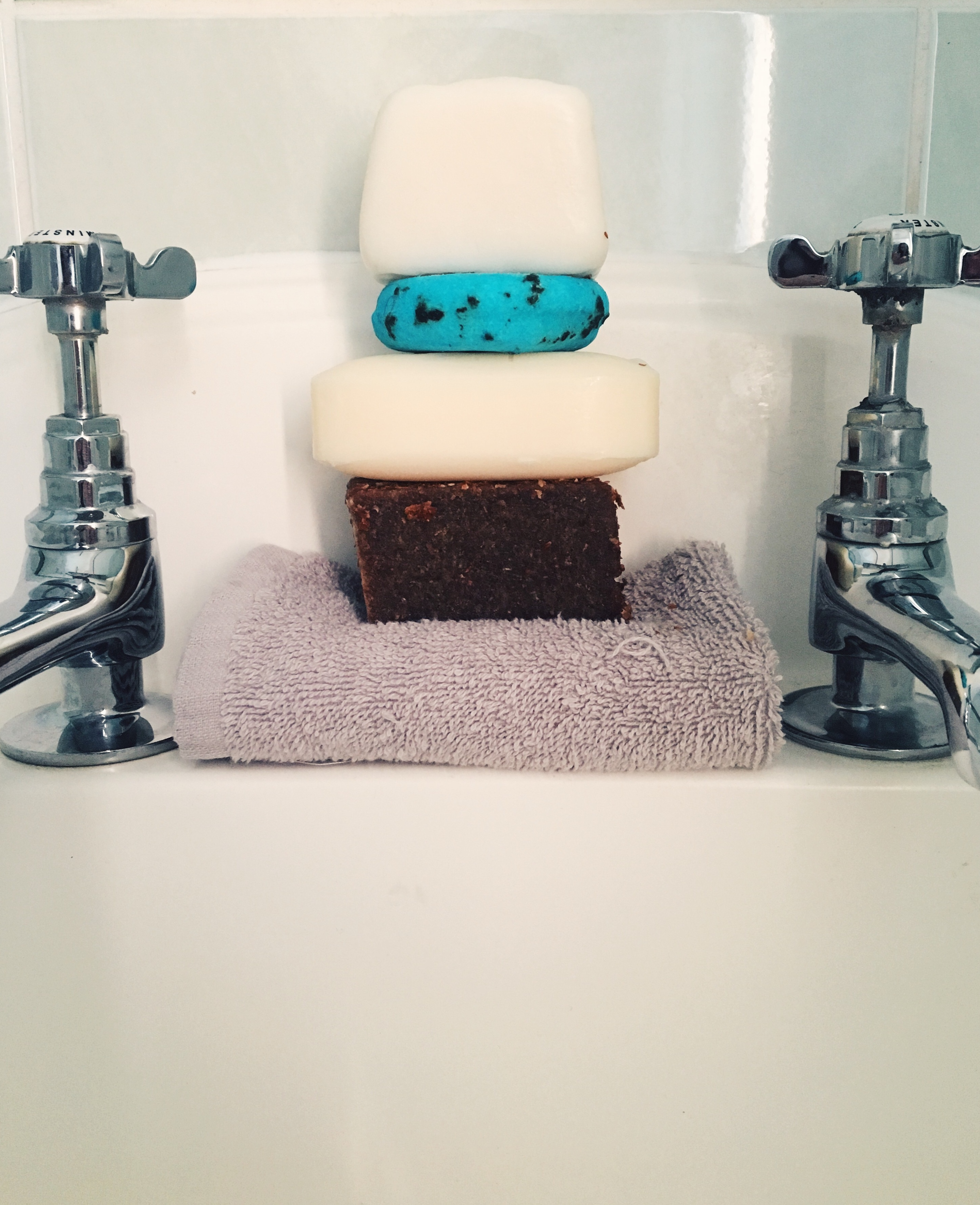 bathroom image of soap bars and a flannel