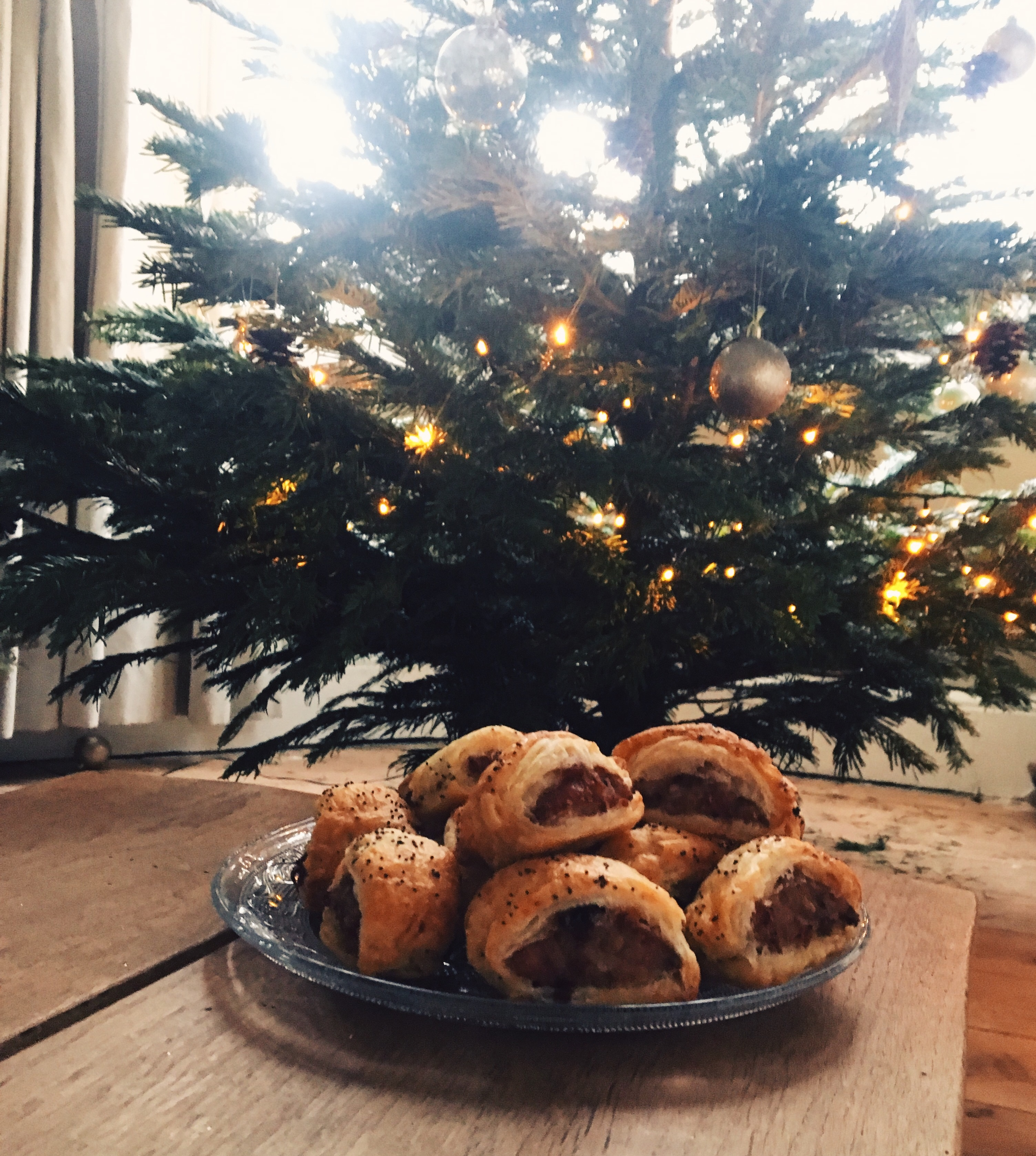 Sausage rolls infront of the Christmas tree
