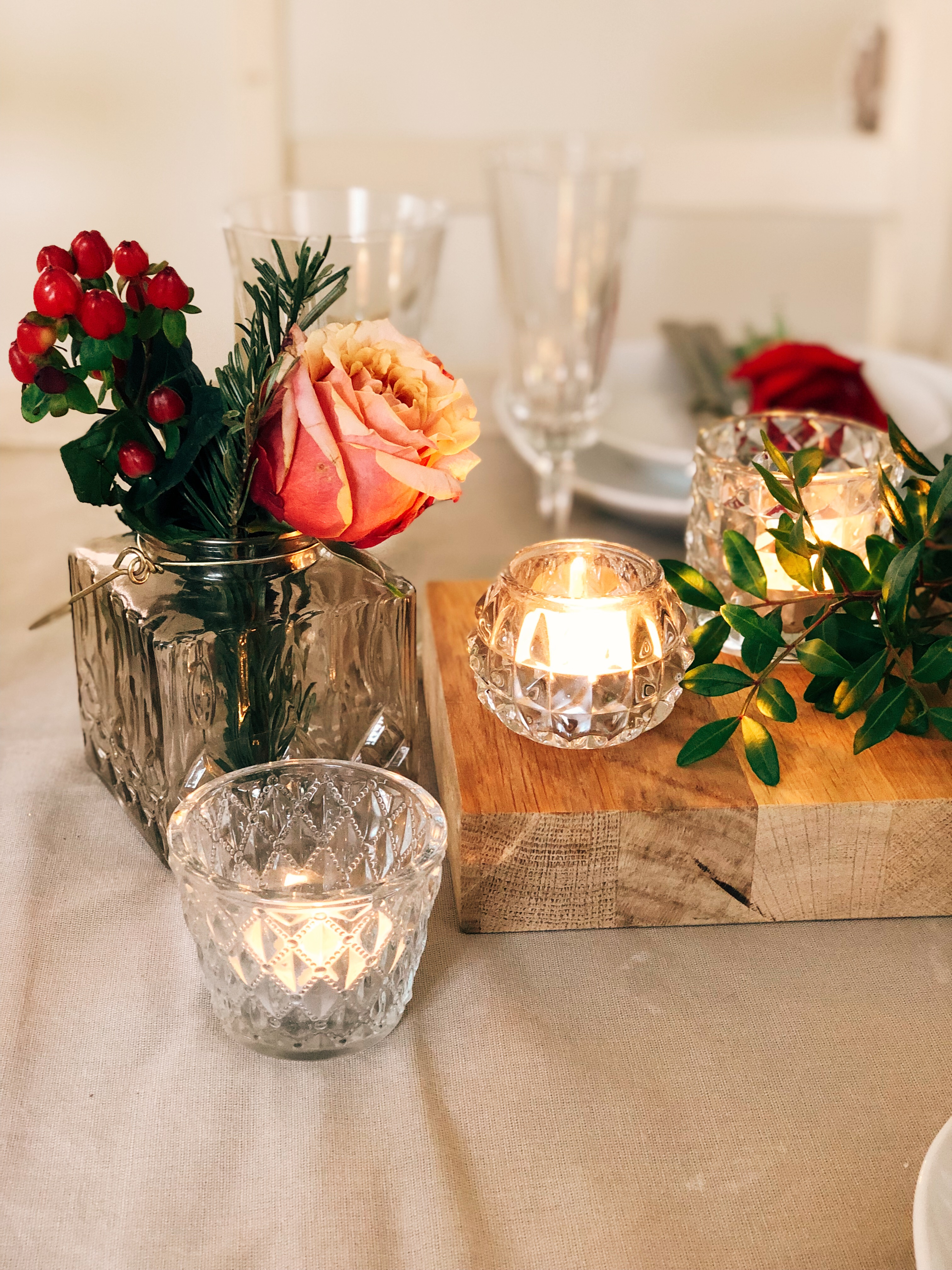 roses in glass vases and candlelight