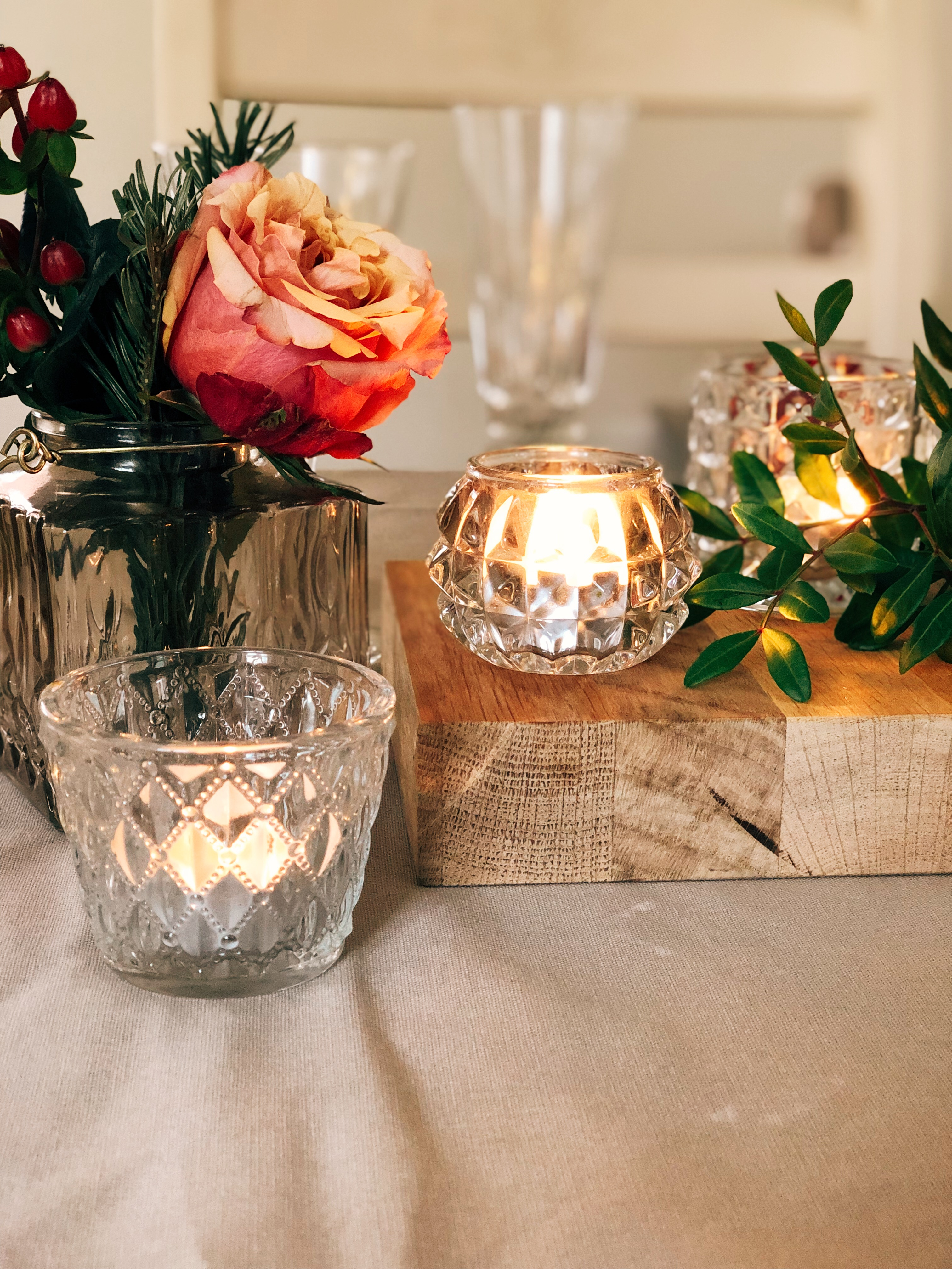 Dusky roses in vintage glassware linen tablecloth