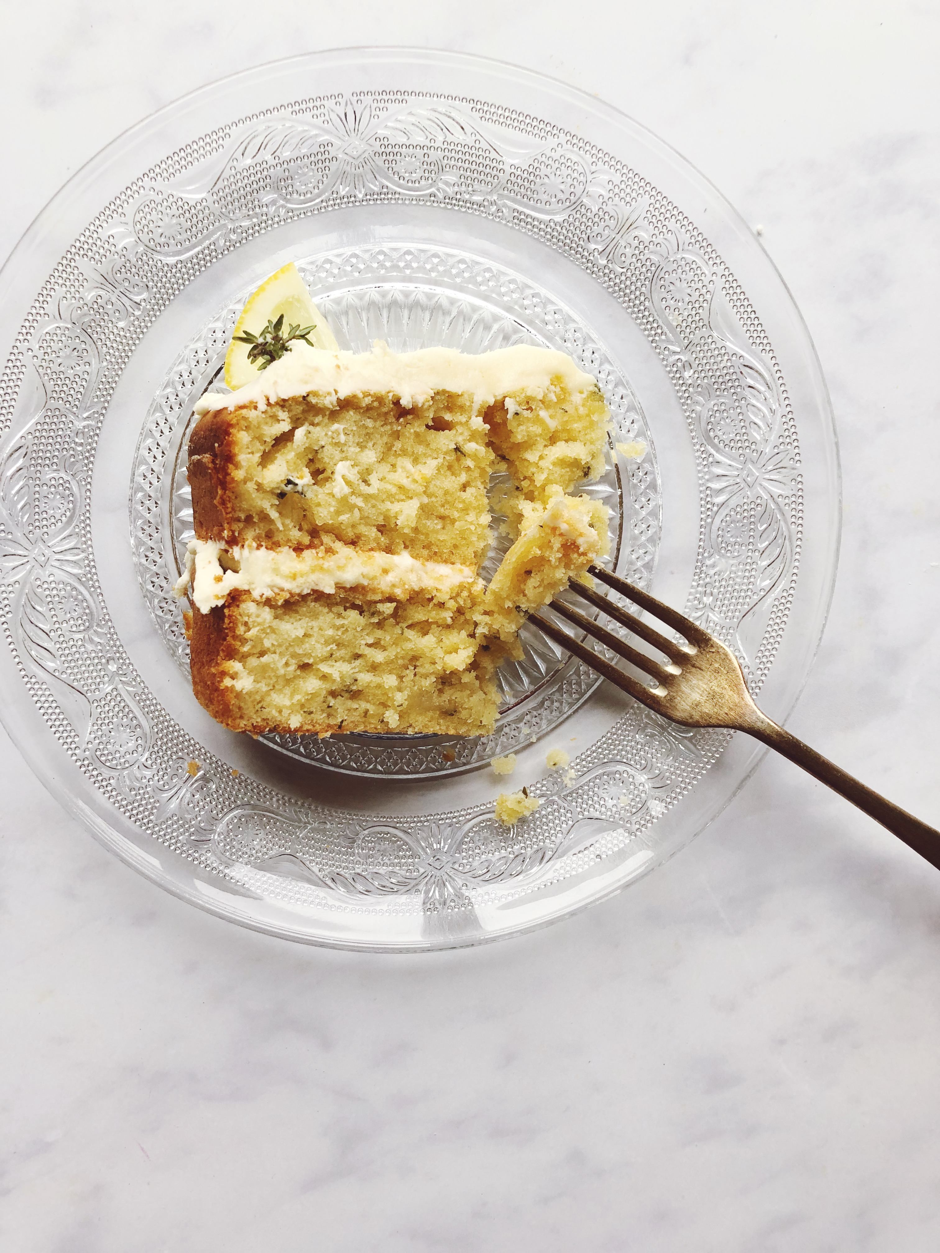 a slice of lemon and thyme sponge cake